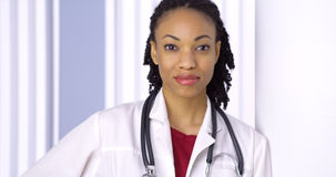 Black woman doctor smiling at camera Stock Photo