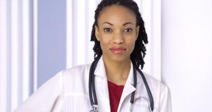 Black woman doctor smiling at camera Stock Photo