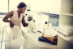 Black woman doing the laundry royalty free stock images
