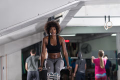Black woman doing parallel bars Exercise. African american athlete woman workout out arms on dips horizontal parallel bars Exercise training triceps and biceps Royalty Free Stock Photos