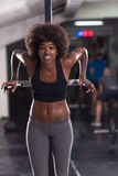 Black woman doing parallel bars Exercise. African american athlete woman workout out arms on dips horizontal parallel bars Exercise training triceps and biceps Stock Image