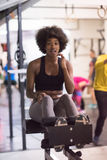 Black woman doing sit ups at the gym Stock Photography