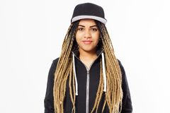 Black woman with dreadlocks in a blank baseball cap and hoodie is on a white background stock photos