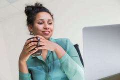 Black woman drinking coffee Royalty Free Stock Images