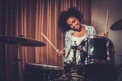 Black woman drummer. In a recording studio stock photo