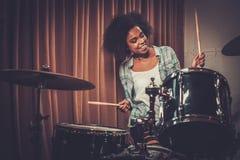 Black woman drummer. In a recording studio stock photos