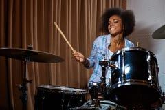 Black woman drummer in a recording studio.  stock image