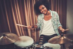 Black woman drummer in a studio. Black woman drummer in a recording studio royalty free stock images