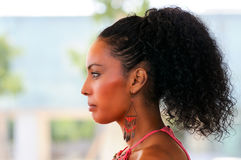 Black woman with earrings. Afro hairstyle Royalty Free Stock Images