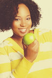 Black Woman Eating Apple Royalty Free Stock Images