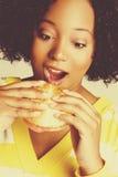 Black Woman Eating Burger Stock Images