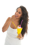 Black woman eating fruit sorbet in glass Royalty Free Stock Image