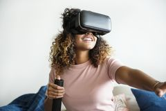 Black woman experiencing virtual reality with VR headset Stock Photography