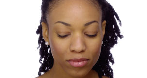 Black woman with eyes closed. Front view of Black woman with eyes closed Royalty Free Stock Images