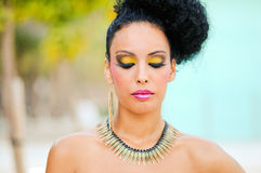 Black woman with fantasy make up. Portrait of a young black woman, model of fashion, with fantasy make up made by a professional beautician Royalty Free Stock Photo