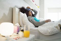 Black Woman With Flu And Cold Holding Ice Bag Royalty Free Stock Photos