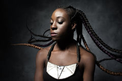 Black woman with the flying braided long hair Royalty Free Stock Photos