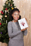 Black woman in front of christmas tree Stock Photos