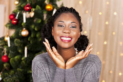 Black woman in front of christmas tree Royalty Free Stock Image