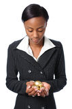 Black woman with gold eggs Royalty Free Stock Photos