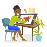 A black woman graphic designer works at the office desk. A black woman graphic designer or freelance artist works using a pen and touch screen at the office Stock Image