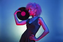 Millennial black woman with groovy hair holding an old eighties royalty free stock photos