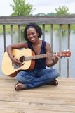 Black Woman with Guitar Royalty Free Stock Photos