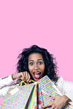 Black woman happy with perfect shopping paper bags, opened mouth. Black woman happy with perfect shopping paper bags Stock Images