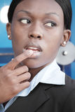 Black woman with her finger on her lips Royalty Free Stock Photo