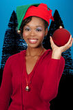 Black Woman Holding a Christmas Ornament Stock Photo