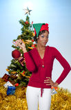 Black Woman Holding a Christmas Ornament Royalty Free Stock Photo