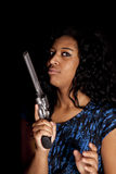 Black woman holding gun Royalty Free Stock Photo