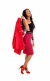 Black woman holding jacket. Royalty Free Stock Image