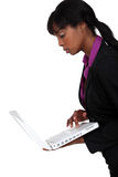 Black woman holding laptop Royalty Free Stock Images