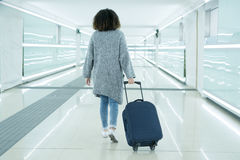 Black woman holding luggage ready to leave Royalty Free Stock Image