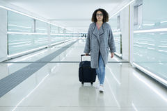 Black woman holding luggage ready to leave Royalty Free Stock Photo