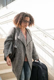 Black woman holding luggage ready to travel Stock Photo