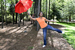 Black Woman Holding an Umbrella Stock Photos