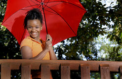 Black Woman Holding an Umbrella Royalty Free Stock Photos