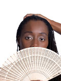 Black woman holding wooden fan before face Stock Photography