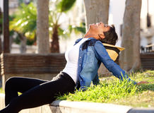Black woman laughing outside. Side portrait of a black woman laughing outside in park Stock Images
