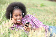 Black woman listening to music Stock Photography