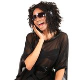 Black Woman Listening to Music on White Background Stock Photo