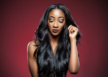 Black woman with long luxurious shiny hair Stock Images