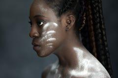 Black woman looking forward Stock Photos