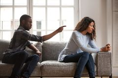 Black woman and man quarrelling at home royalty free stock photo