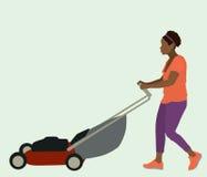 Black Woman Mowing Lawn Royalty Free Stock Photos