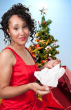 Black Woman Opening a Christmas present Stock Images