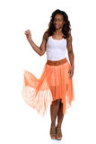 Black woman with orange sheer dress Stock Images