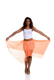 Black woman with orange skirt Stock Images
